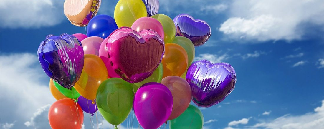 Lots of flying baloons in different colors