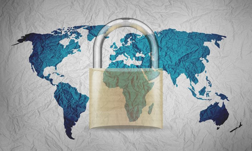 A world map covered with a large padlock.