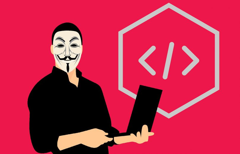 A man with an Anonymos mask holding a computer up to no ggod. A html-tag. Pink background.